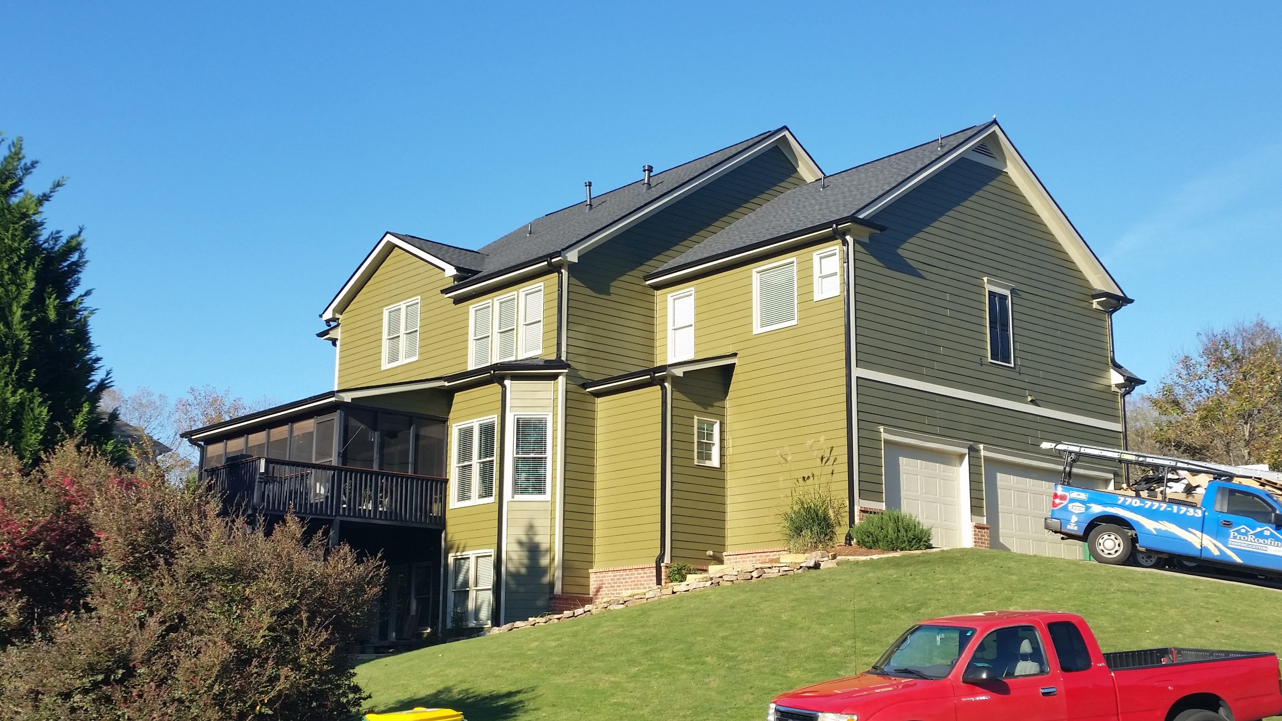 Siding installation in a light green color on a residential home