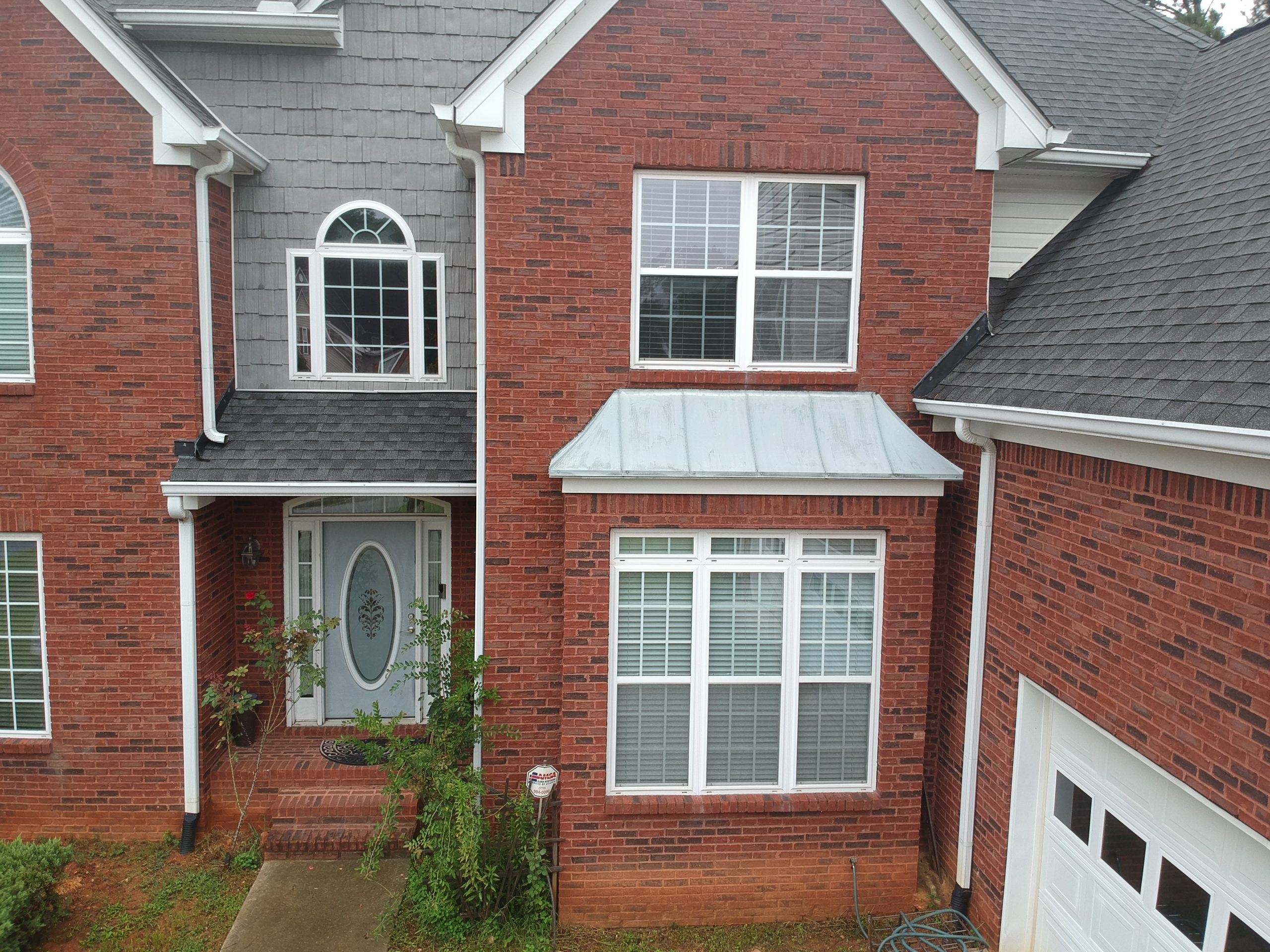 Red brick home with newly installed windows in Woodstock