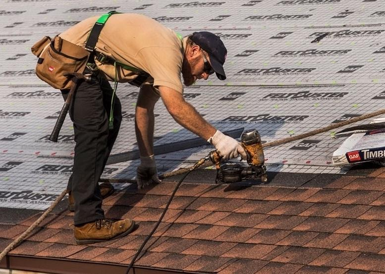 Roof replacement worker